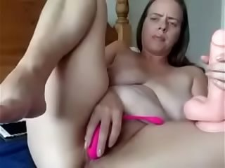mature woman masturbating on..