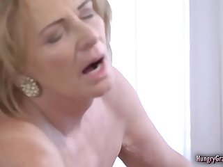 Bigtitted granny fucked by a..