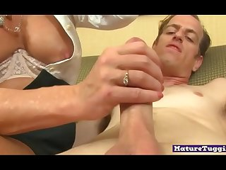Busty cougar jerking dick..
