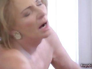 Horny blonde grandma..