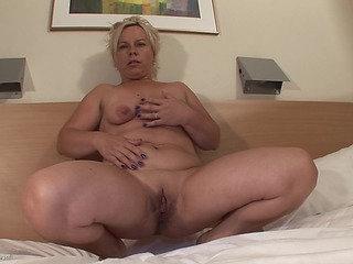 Older striptease in a hotel..