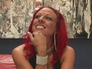 Redhead MILF with big tits..