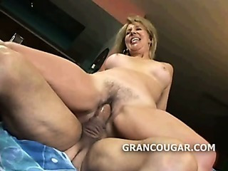 Blonde granny riding cock as..