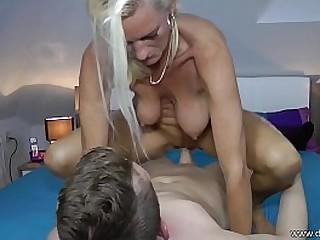 Milf fucks young boy